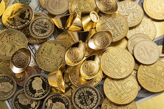 市場預期美聯儲下月宣布縮減,美元堅挺黃金持平